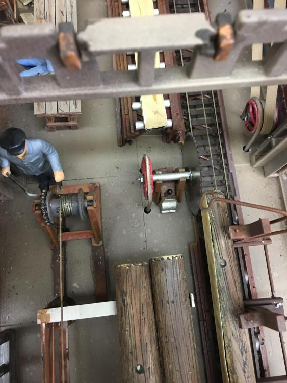 sawmill looking down on the main blade and log puller.JPG
